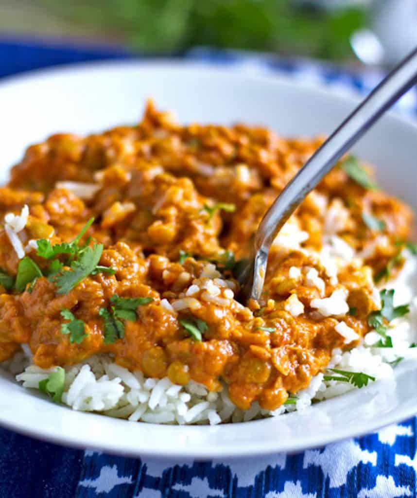 Pinch of Yum's Red Curry Lentils are a flavor explosion in your mouth. Check out the other recipes and menus in this post for your next casual dinner party.