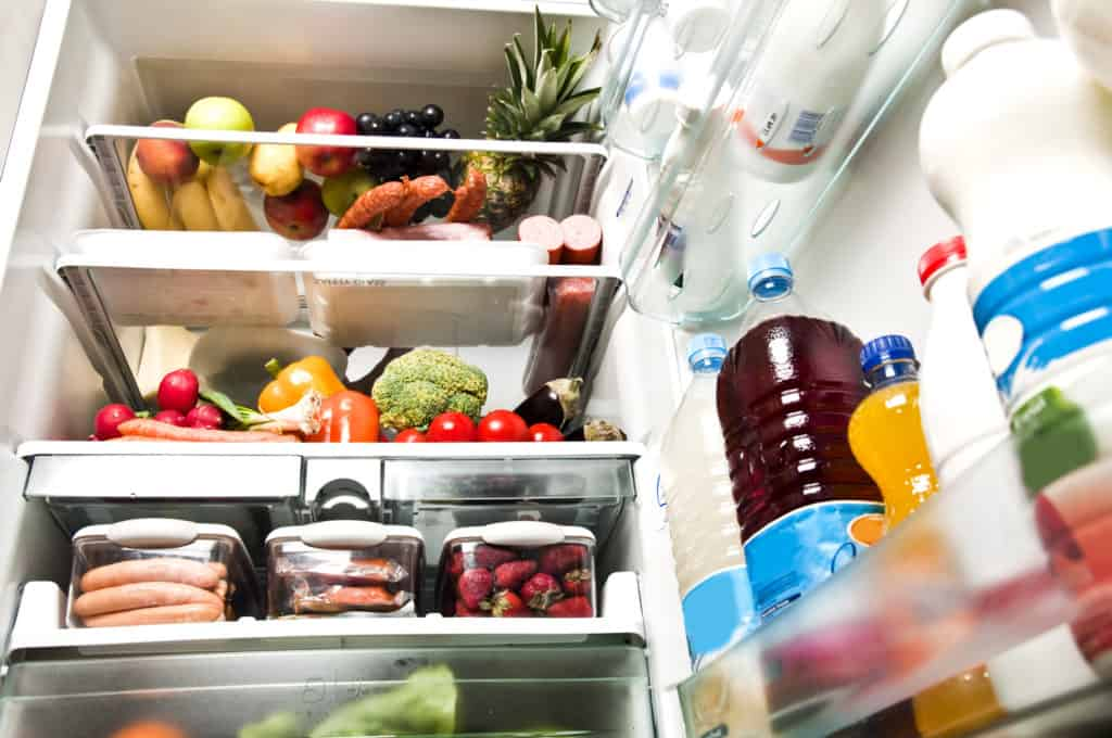 fridge full of food illustrating you should raid your fridge and pantry first when entertaining on a budget