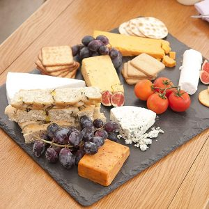 Black Slate Board with cheese, crackers, and fruit