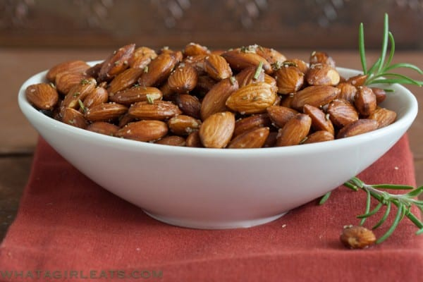 white bowl of roasted almonds