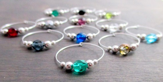 collection of crystal charms for wine glasses