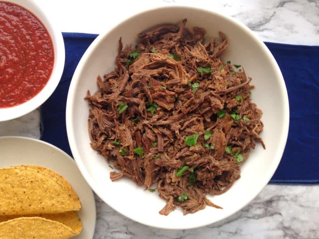 shredded mexican meat in a white bowl
