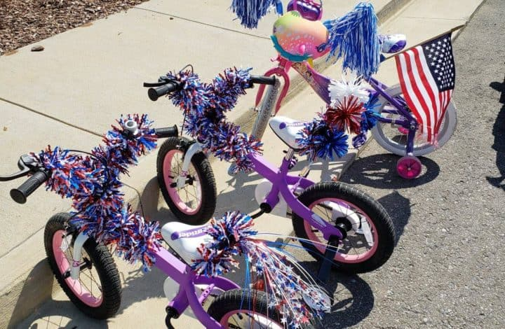 three kids' bikes decorated for 4th of July