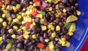 close-up of blue dish with black bean and corn salad