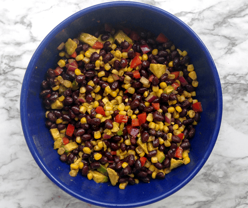 blue bowl of black bean and corn salad